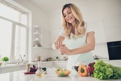 Free Portrait Of Nice Attractive Cheerful Wavy-haired Lady Making Healthy Weightloss Vitamin Tasty Yummy Delicious Dinner Royalty Free Stock Photography - 153983287