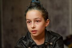 Free Portrait Of Nine Year Old Girl. Teenager With Blue Strands On Her Hair. A Series Of Photos Of A Girl Of 8 Or 9 Years Old Stock Image - 172512031