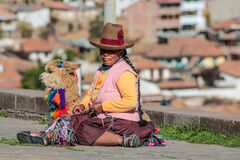 Free Portrait Of Peruvian Old Woman Sitting On The Street With Lama Stock Images - 218017714