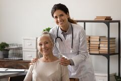 Free Portrait Of Physician And Senior Woman Patient Looking At Camera Stock Images - 218284924