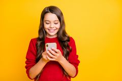 Free Portrait Of Positive Cheerful Wavy Long Hair Model Child Use Her Cellphone Read Feednews Blog Posts Feel Content Royalty Free Stock Photo - 160284865