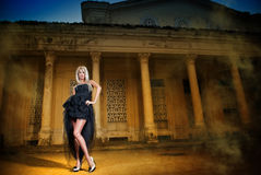 Portrait Of Pretty Woman Standing In Black Elegant Dress Outdoors Royalty Free Stock Photography