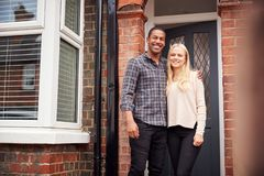 Free Portrait Of Proud Young Couple Standing Outside First Home Together Royalty Free Stock Image - 163720746