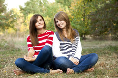 Portrait Of Redhead And Brunette Girls At Outdoor. Royalty Free Stock Photos
