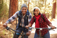 Free Portrait Of Senior Couple Cycling In Fall Woodland Stock Photo - 71526880