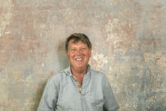 Portrait Of Senior Man In Front Of Grungy Old Wall Royalty Free Stock Photo