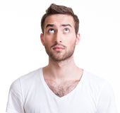 Portrait Of Serious Handsome Young Man Looking Up. Stock Image