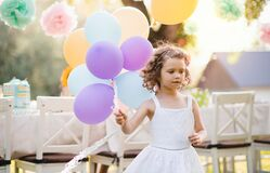 Free Portrait Of Small Girl Playing With Balloons Outdoors On Garden Party In Summer. Stock Photo - 181600010