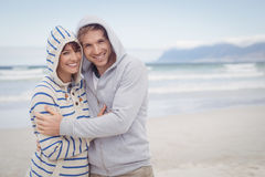 Free Portrait Of Smiling Couple Wearing Hooded Sweater During Winter Stock Photography - 91777222