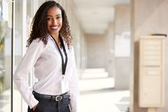 Free Portrait Of Smiling Female School Teacher Standing In Corridor Of College Building Royalty Free Stock Photo - 144595265