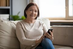 Free Portrait Of Smiling Middle Aged Lady Resting On Sofa. Royalty Free Stock Photography - 174979677