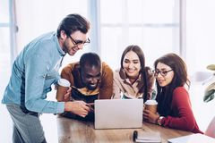 Free Portrait Of Smiling Multicultural Business People Working On Laptop Together Royalty Free Stock Photo - 127764875