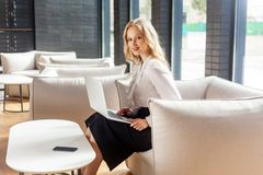Free Portrait Of Stunning Beautiful Wealthy Woman With Blond Hair In Classic Clothes Sitting On Comfortable Couch Holding Laptop And Stock Images - 166075434
