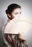 Portrait Of The Girl With A Fan. Royalty Free Stock Photos