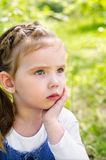 Portrait Of Thinking Little Girl Outdoor Royalty Free Stock Image