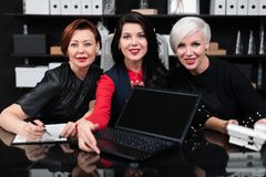 Portrait Of Three Business Women At Work In Stylish Office Royalty Free Stock Photography
