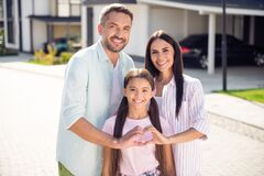 Free Portrait Of Three Lovely Adorable Cheery Family Embracing Showing Heart Shape Sunny Day Dream In Cottage Town Outdoor Royalty Free Stock Image - 215382206