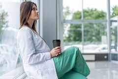 Free Portrait Of Tired Exhausted Nurse Or Doctor Having A Coffee Break In Hospital. COVID-19, Coronavirus Pandemic. Royalty Free Stock Image - 190261226