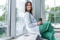 Free Portrait Of Tired Exhausted Nurse Or Doctor Having A Coffee Break In Hospital. COVID-19, Coronavirus Pandemic. Royalty Free Stock Photos - 190261348