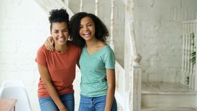 Free Portrait Of Two Beautiful African American Girls Laughing And Looking Into Camera At Home Royalty Free Stock Image - 106459606