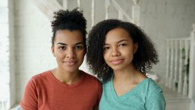 Free Portrait Of Two Beautiful African American Girls Smiling And Looking Into Camera At Home Royalty Free Stock Photos - 106459538