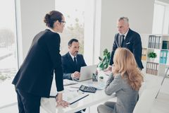 Free Portrait Of Two Stylish Business Persons In Suits Having Disagreement, War, Conflict, Standing Near Desktop In Front Of Each Royalty Free Stock Photos - 116069248
