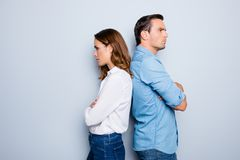 Free Portrait Of Unhappy Frustrated Couple Standing Back To Back Not Speaking To Each Other After An Argument While Standing On Grey Ba Stock Photography - 111127372