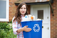 Free Portrait Of Woman Carrying Recycling Bin Stock Photography - 66675392