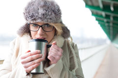 Free Portrait Of Woman Drinking Coffee From Insulated Drink Container During Winter Royalty Free Stock Photography - 55570927