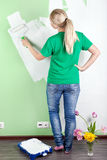 Portrait Of Woman Painting The Wall Royalty Free Stock Photography