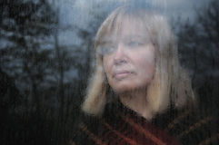 Portrait Of Woman Through The Window Royalty Free Stock Images