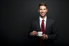 Portrait Of Young Attractive Businessman Drinking Coffee Royalty Free Stock Photos