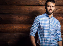 Free Portrait Of Young Beautiful Fashionable Man Against Wooden Wall. Stock Images - 43725994