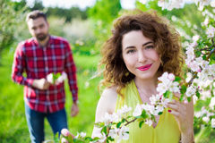 Portrait Of Young Beautiful Woman With Her Boyfriend In Garden Royalty Free Stock Image