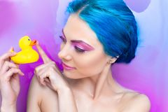 Free Portrait Of Young Female In Bathtub With Pink Water Stock Photography - 122356632