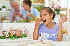 Portrait Of Young Girl Eating In The Kitchen Royalty Free Stock Image