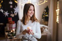 Free Portrait Of Young Girl Indoors At Home At Christmas, Holding Candle. Royalty Free Stock Photography - 197477127