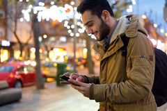 Free Portrait Of Young Man Using His Mobile Phone On The Street At Ni Royalty Free Stock Images - 48950109