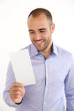 Portrait Of Young Man With Blank Leaflet Isolated Royalty Free Stock Photos