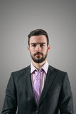 Portrait Of Young Serious Businessman With Intense Look At Camera Stock Images