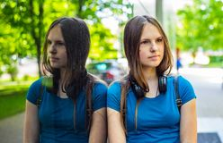 Free Portrait Of Young Teenager Brunette Girl With Long Hair. An Urban Environment Of A Street Warehouse, Woman And Reflection In The G Royalty Free Stock Photo - 153204755