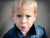 Portrait of the offended little boy Royalty Free Stock Photo