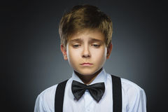 Portrait of offense crying boy isolated on gray background. Negative human emotion, facial expression. Closeup Stock Photo
