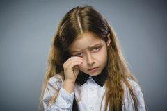 Portrait of offense crying girl isolated on gray background. Negative human emotion, facial expression. Closeup Stock Photography