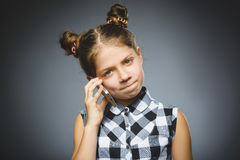 Portrait of offense girl with mobile or cell phone. Negative human emotion. Facial expression. Closeup royalty free stock photos