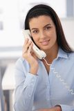 Portrait of office girl on call Royalty Free Stock Images