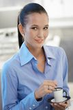 Portrait of office girl having coffee Royalty Free Stock Photo