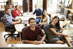 Portrait Of Office Staff At Table In Architect's Office. Smiling At Camera Stock Photography
