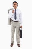 Portrait of an office worker holding his jacket over his shoulde Royalty Free Stock Images