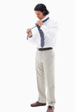 Portrait of an office worker putting his tie Royalty Free Stock Images